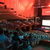The view within the conference. Bathed in red, the colour for the conference.