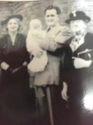 I'm in Dad's arms at my christening in 1950, Gran is on the left of the photo and her mum, my great grandmother is on the right.